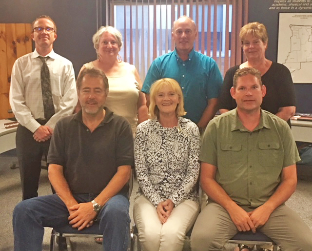 board picture 18-19 Jeff Brownell, Colleen Locke, Dan Marvin (L-R, Front Row), Bryan Liam Kennelly, Martha Spear, Rick Preston, Joan Hallett Valentine (L-R, Back Row)